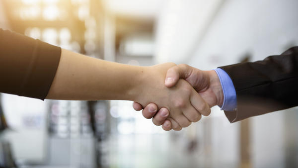 A Muslim woman who refused to shake hands on a job interview won her discrimination case in Sweden on Wednesday.