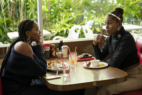 Orji, left, and Issa Rae star in HBO's <em>Insecure, </em>which is now in its third season.