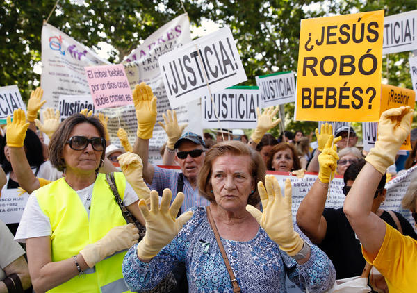 Spaniards take part in a protest over Spain's stolen babies scandal outside a court in Madrid, on June 26. No Spanish government has acknowledged the alleged cases.