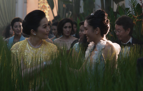 In the movie <em>Crazy Rich Asians</em>, Princess Intan (Kris Aquino, left) and economist Rachel Chu (Constance Wu) meet at a wedding in Singapore and have a little tete-a-tete about, of all things, microloans.