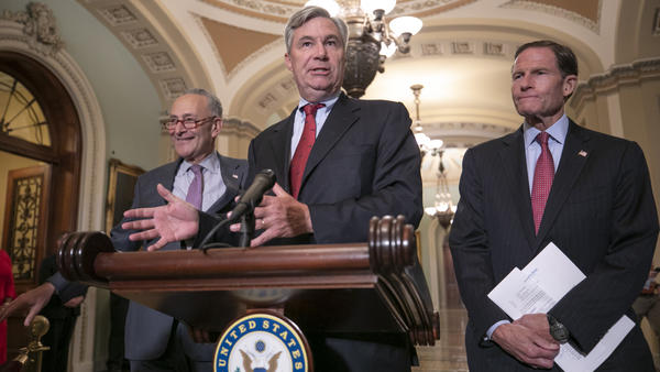 Sen. Sheldon Whitehouse, D-R.I., flanked by Senate Minority Leader Chuck Schumer, D-N.Y. (left), and Sen. Richard Blumenthal, D-Conn., at a news conference Thursday, where they said they will sue the National Archives if they don't get the documents on Supreme Court nominee Brett Kavanaugh that they requested.