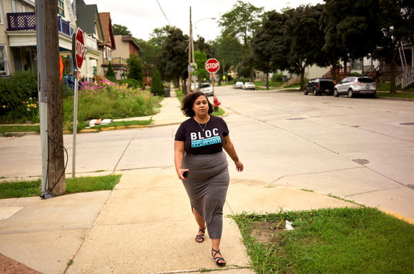 Angela Lang, left, executive director of BLOC, Black Leaders Organizing for Communities walks back to the organizations headquarters, Aug. 7, 2018 Milwaukee.
