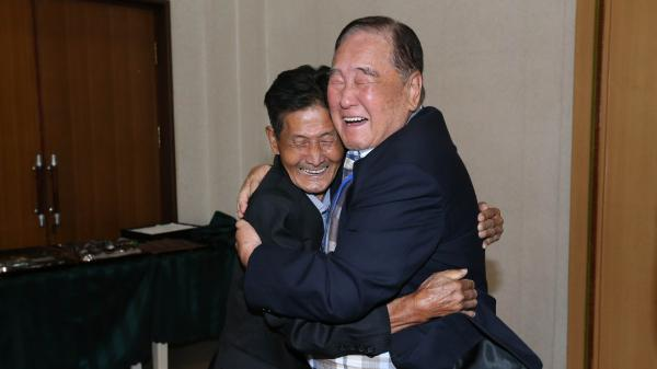 Ham Sung-chan, 93, (right) of South Korea hugs his North Korean brother Ham Dong Chan, 79, during a family reunion meeting at the Mount Kumgang resort on the North's southeastern coast.