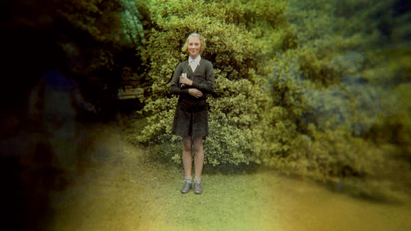 A young Jane Goodall poses for a picture in her school uniform in Bournemouth, England. (Jane Goodall Institute)