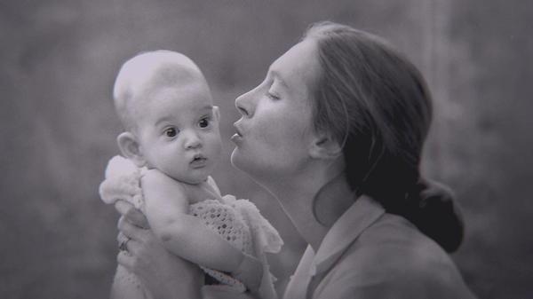 Gombe, Tanzania: Jane Goodall kisses her son Grub. (Jane Goodall Institute/Hugo van Lawick)