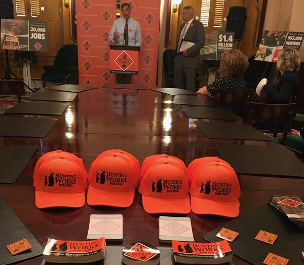 Tom Vorisek, co-chair of Hunting Works For Ohio, launches the group with table full of promotional items.
