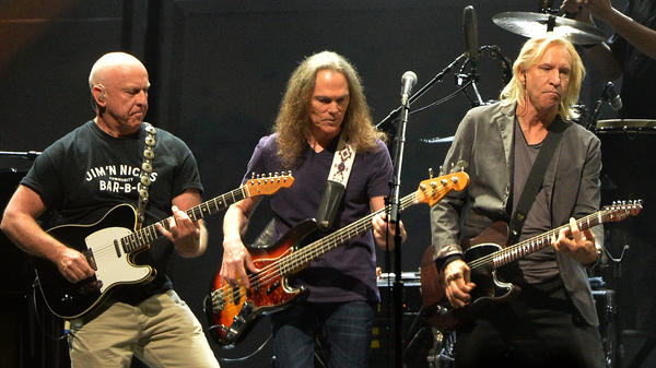"Bernie Leadon, Timothy B. Schmit and Joe Walsh of the Eagles perform during ""History Of The Eagles Live In Concert"" in October 2013 in Nashville."