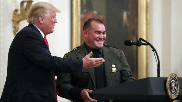 "President Trump with Customs and Border Patrol agent Adrian Anzaldua, whom he praised for finding around 80 immigrants in a tractor-trailer and for his ""perfect English."""