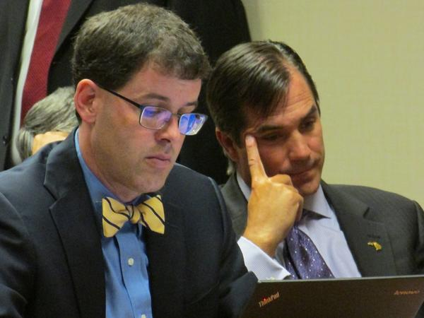 Nick Lyon (right) listens as a judge orders that he face trial on involuntary manslaughter and other charges.