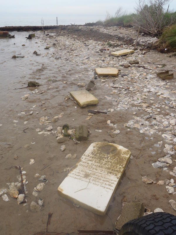 Gravestones and bricks litter the beach at Canaan, a once-thriving Tangier settlement abandoned 90 years ago as the Chesapeake encroached on its homes.