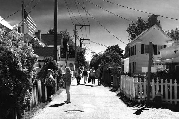 Tourists walk the Main Ridge Road on Tangier Island; they're a frequent presence in the summer months.