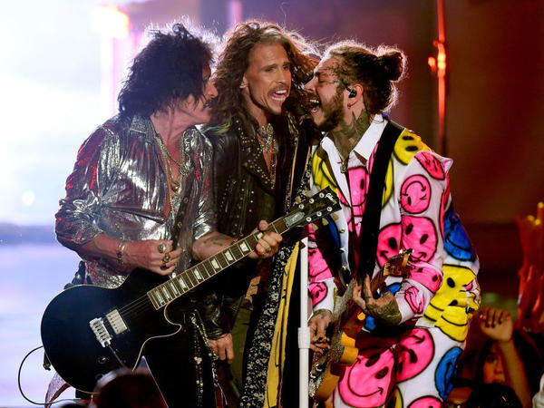 Joe Perry, Steven Tyler and Post Malone (L-R), performing onstage at the 2018 MTV Video Music Awards on Monday night.