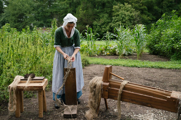Deborah Colburn, a historic trade interpreter at Mount Vernon, demonstrates the process of turning dried hemp into a pliable fiber for making cloth.