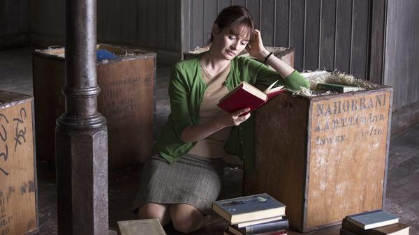 Florence (Emily Mortimer) unpacks her inventory in an adaptation of Penelope Fitzgerald's 1978 novel <em>The Bookshop.</em>