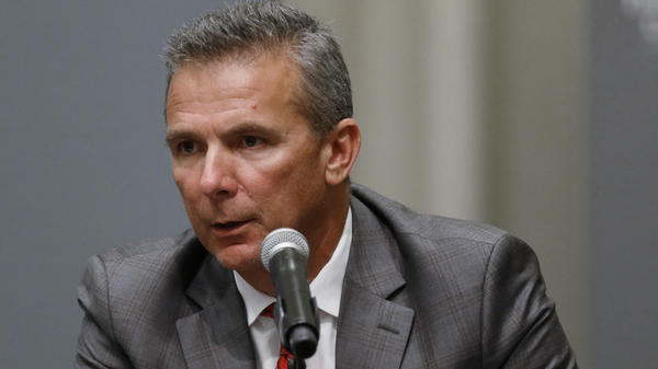 Ohio State football coach Urban Meyer makes a statement during a news conference in Columbus, Ohio on Wednesday.