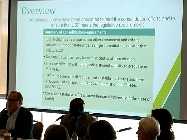 A slide shows the state mandates the USF Consolidation Task Force faces.