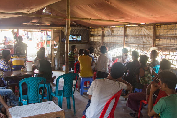 Men watch a Hindi action movie on a TV in the Police Station Restaurant in the Balukhali 2 Rohingya refugee camp.
