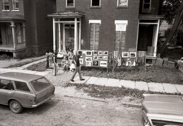 Photographer Steve Baldwin photographs and his former wife, Linda Baldwin's macrame on display outside 34 Atkinson St. at the 1972 Corn Hill Art Show
