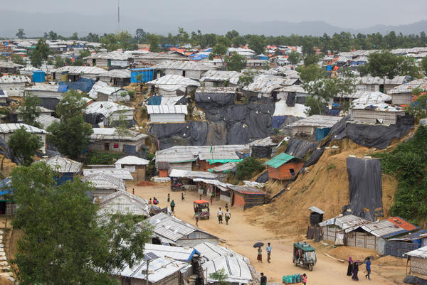 The steep, sandy hills in Bangladesh's Rohingya refugee camps are covered in black plastic to keep them from eroding away in the intense monsoon rains.