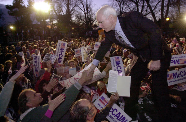 Arizona senator and Republican presidential hopeful John McCain shakes the hand of a supporter at Jastro Park in Bakersfield, Calif., on Feb. 29, 2000.