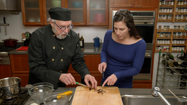 Chef David George Gordon shows biologist and host Haley Chamberlain Nelson how to prepare a tarantula meal on <em>Bug Bites</em>. The new five-part cooking show from Smithsonian Channel makes insects the star ingredient.