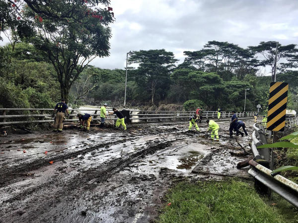 Crews on Friday worked at clearing damage from Hurricane Lane near Hilo, Hawaii. The hurricane dumped torrential rains which inundated the Big Island's main city.