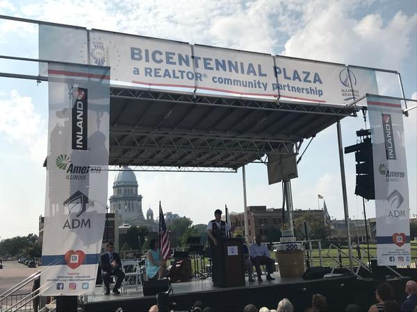 Gov. Bruce Rauner talks to the crowd at the dedication of Bicetennial Plaza in Springfield Sunday.
