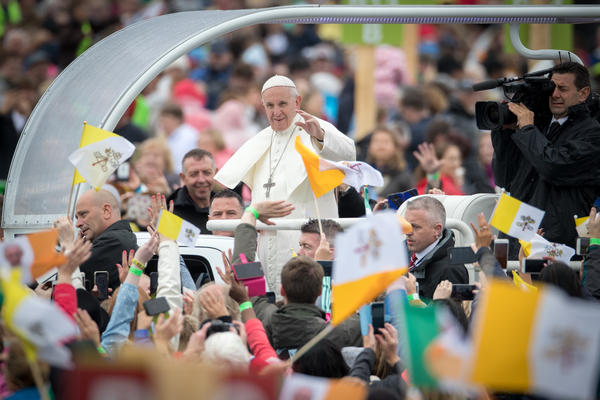 Pope Francis arrives as people gather for the Mass in Phoenix Park on Sunday in Dublin.