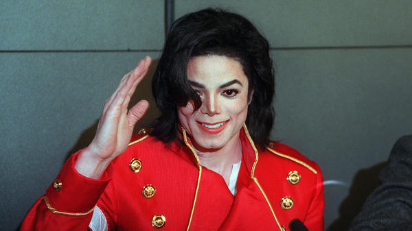 Michael Jackson waves to photographers during a 1996 press conference in Paris. The first posthumous album by the King of Pop, who died in 2009, has been trailed by controversy since its 2010 release.