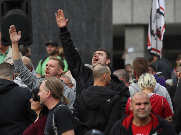 A man raises his arm in a Nazi salute in response to heckling from leftists at a protest gathering the day after a fatal stabbing by migrant suspects triggered large protests in the city of Chemnitz in eastern Germany.