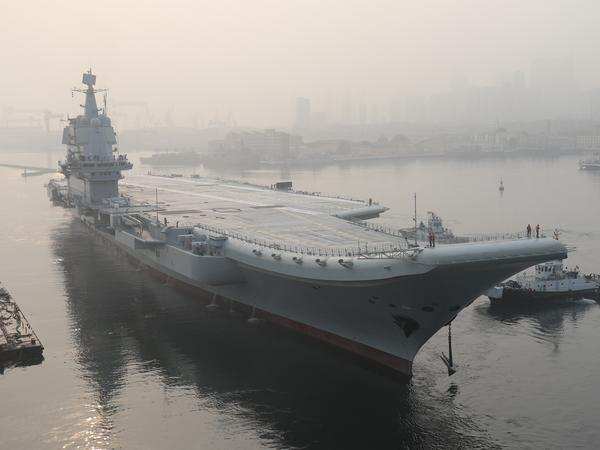 "China's first domestically manufactured aircraft carrier, known only as ""Type 001A"", leaves port in the northeast city of Dalian in May. The vessel has reportedly begun sea trials ahead of its commissioning, expected next year."