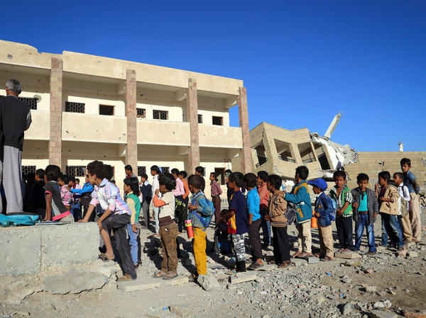 Yemeni children gather outside their classroom in  Dec. 2016, at a school that was recently damaged in a Saudi-led air strike in the country's third-city of Taez.