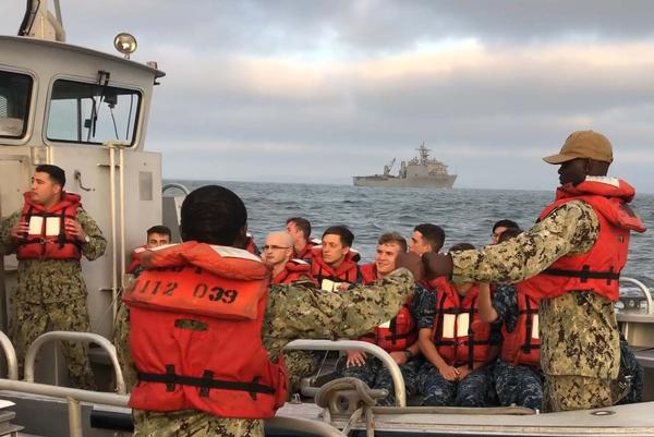 Midshipmen from the Naval Academy depart the USS Higgins after a recent training exercise.