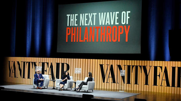 Ford Foundation President Darren Walker, Chan Zuckerberg Initiative co-founder Priscilla Chan and Goldman Sachs Foundation President Dina Powell speak during the Vanity Fair New Establishment Summit in 2016 in San Francisco.