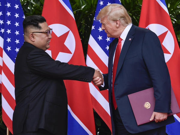North Korea leader Kim Jong Un and President Trump shake hands at the conclusion of their meetings at the Capella resort on Sentosa Island, in Singapore, on June 12.
