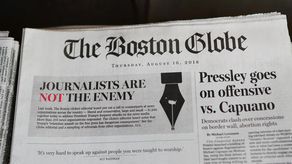 The front page of the Aug. 16 edition of <em>The Boston Globe</em>. On Thursday, a California man was charged with threatening the newspaper in retaliation for its national editorial campaign criticizing President Trump's assault on the free press.