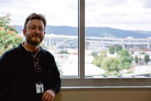 <p>Paul Bubl teaches science at Harriet Tubman Middle School in Portland. His room has a view of the Fremont Bridge and Forest Park — and Interstate 5, if you look down.</p>