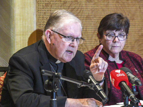Australian Catholic Bishops Conference President Archbishop Mark Coleridge speaks to the media alongside Catholic Religious Australia President Sister Monica Cavanagh, right, during a news conference in Sydney on Friday in response to the child abuse royal commission's recommendations.
