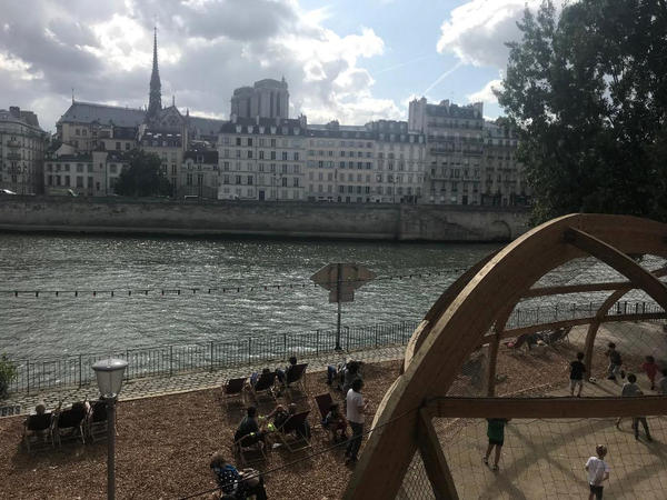 The city of Paris organizes Paris Plage or Paris Beach every July and August, closing down a mile-long section of roadway next to the Seine, trucking in sand and bringing in lounge chairs and palm trees. There are cafes, live music and games for children.