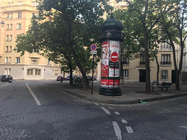 A normally busy street in the 16th arrondissement is quiet in August.