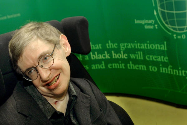 Stephen Hawking smiles during a 2002 symposium in honor of his 60th birthday at the University of Cambridge. Hawking has died at 76.