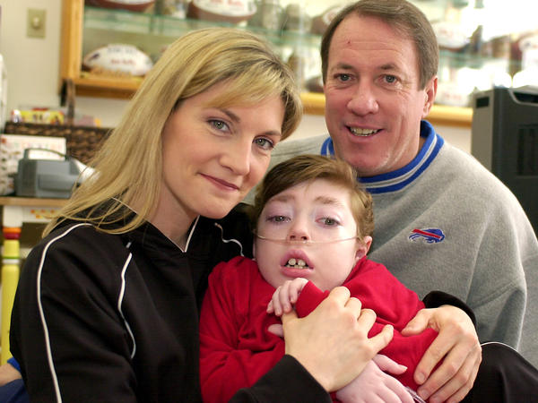 Jim and Jill Kelly with their son Hunter in 2004. Hunter, who had Krabbe disease, died in 2005 at age 8.