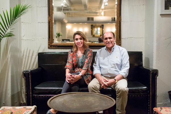 """Zubair Popal, and his daughter, Fatima Popal. The Popal family fled Afghanistan in 1980. Today, they're successful D.C. restaurateurs. He recently hosted a Refugees Welcome dinner at his restaurant, Lapis. """"We came here exactly like these people,"""" he says, adding, """"I know for these people it's very hard, very hard."""""""