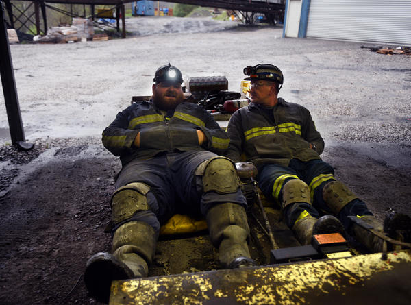 Bobby Jr. Sargent and Paul Stalker, employees at Cavalier, prepare to drive into the mine. The seats on their vehicle are reclined to allow clearance under the mine's low ceiling.