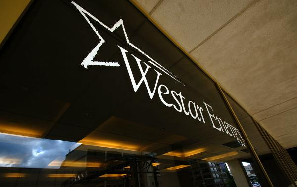 A merger proposal approved by Kansas regulators on Thursday requires Westar to keep 500 employees at its Topeka headquarters for the next half-decade.