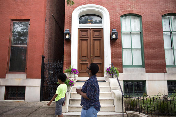 Devan Southerland and her son, Liam, stroll through the historic Bolton Hill neighborhood in Baltimore, where Southerland wants to buy a home.