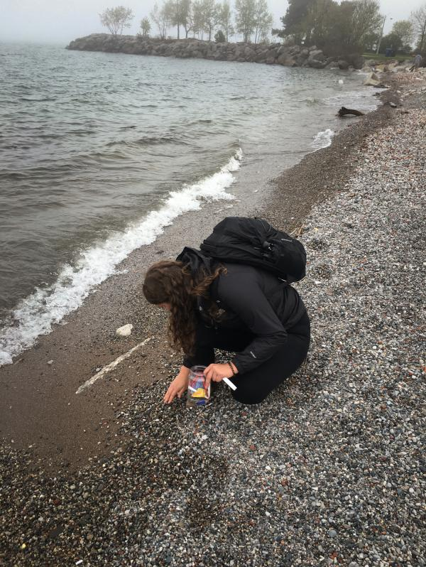 Researcher Kennedy Bucci collects plastics from the shore of Lake Ontario in Toronto.