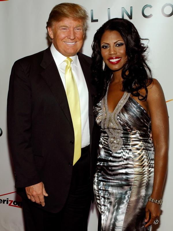 Donald Trump and Omarosa Manigault attend <em>The Ultimate Merger</em> premiere at Trump Tower in 2010. Manigault appeared on the first season of <em>The Apprentice</em> and made later appearances on other Trump reality shows.