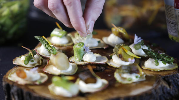 Assistant chef Michael Monteleone puts a finishing touch on cannabis-infused vegetable tarts. As more states legalize the use of recreational marijuana, the California chef is aiming to elevate haute cuisine to a new level.