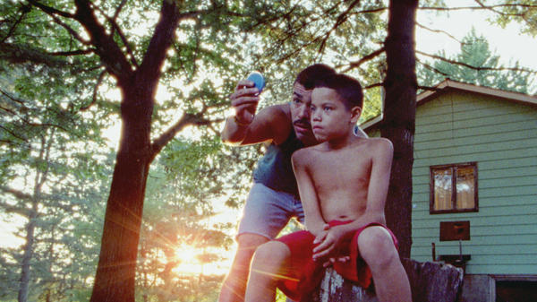 Jonah (Evan Rosado) is the youngest of three children who roam under the auspices of their father (Raul Castillo) in the film adaptation of <em>We the Animals.</em>